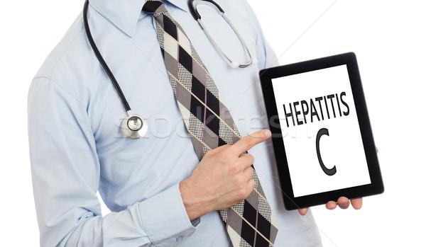 Doctor holding tablet - Hepatitis C Stock photo © michaklootwijk