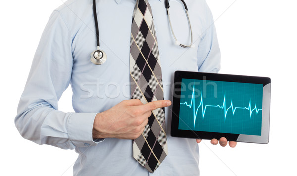 Doctor holding tablet - Heartbeat graph Stock photo © michaklootwijk