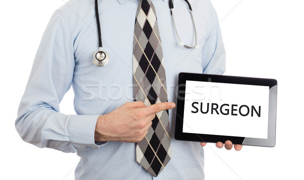 Doctor holding tablet - Surgeon Stock photo © michaklootwijk