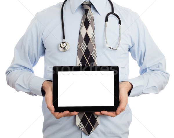 Doctor holding tablet with copy space and clipping path for the  Stock photo © michaklootwijk