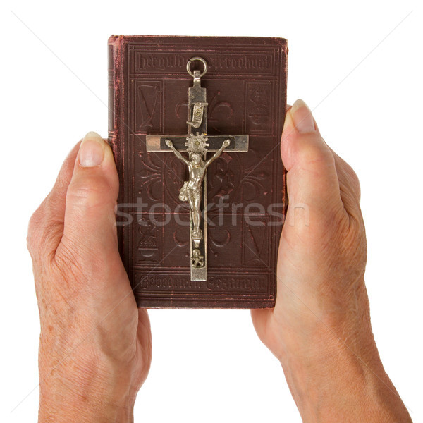 Old hands (woman) holding a very old bible Stock photo © michaklootwijk