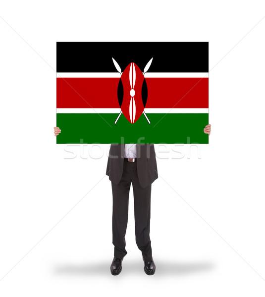 Businessman holding a big card, flag of Kenya Stock photo © michaklootwijk