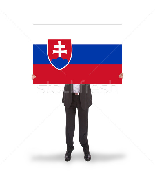Businessman holding a big card, flag of Slovakia Stock photo © michaklootwijk