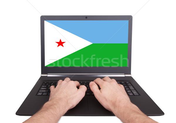 рук рабочих ноутбука Джибути экране Сток-фото © michaklootwijk