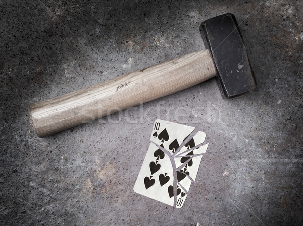 Hammer with a broken card, ten of spades Stock photo © michaklootwijk