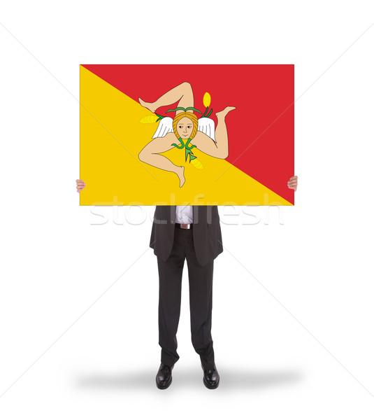 Uśmiechnięty biznesmen duży karty banderą Zdjęcia stock © michaklootwijk