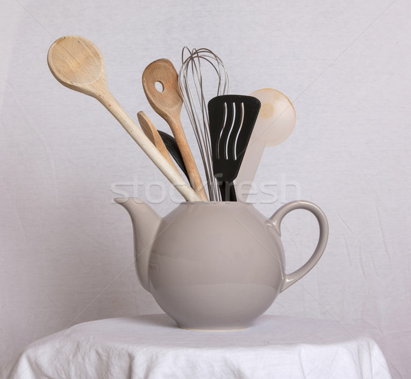 Old teapot filled with spoons Stock photo © michaklootwijk