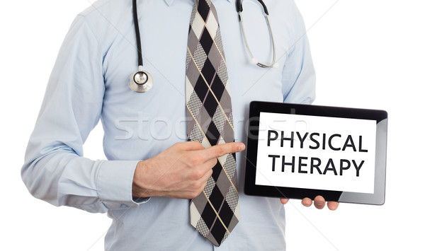 Doctor holding tablet - Physical therapy Stock photo © michaklootwijk