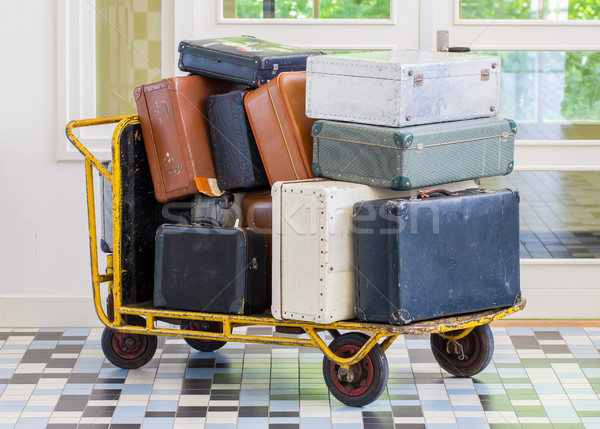 Trolley full of old luggage Stock photo © michaklootwijk
