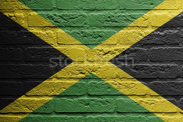Téglafal festmény zászló Jamaica izolált festék Stock fotó © michaklootwijk