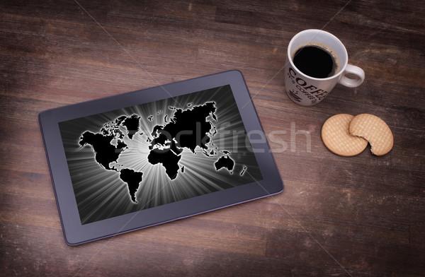 Мир карта таблетка бизнеса компьютер древесины карта Сток-фото © michaklootwijk