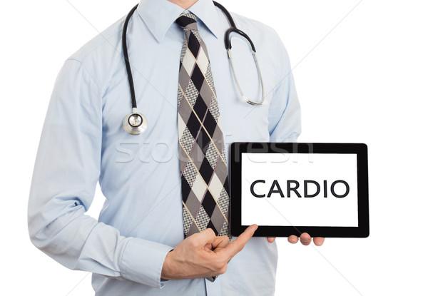 Orvos tart tabletta kardio izolált fehér Stock fotó © michaklootwijk