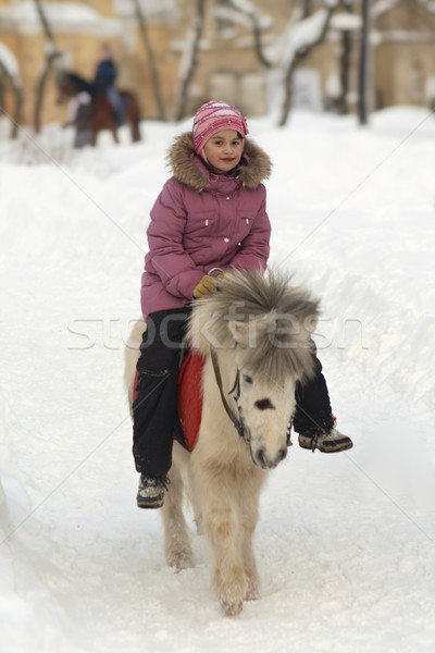 Little girl on a white pony Stock photo © michey
