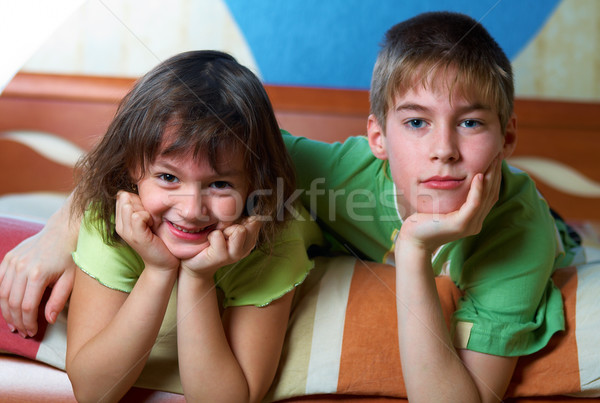 Children lying on their bellies in a bedroom Stock photo © michey
