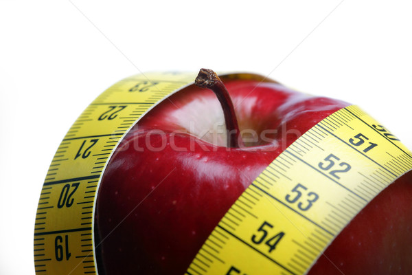 Red apple with measurement isolated on white  Stock photo © mikdam