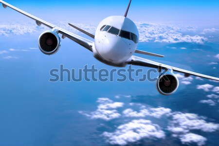 Airplane above the clouds, Stock photo © mikdam