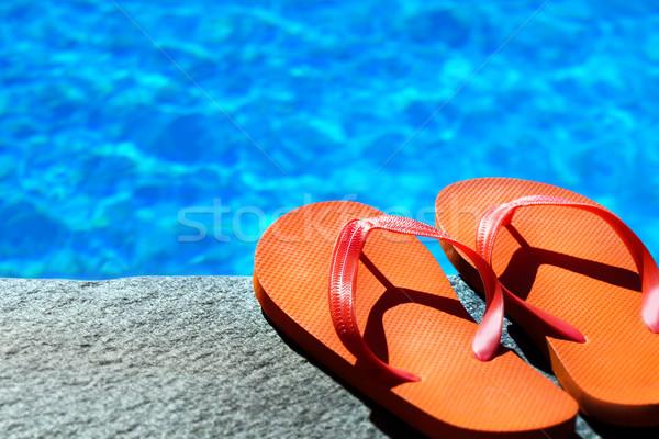 Sandalen zwembad water oranje schoen cool Stockfoto © mikdam