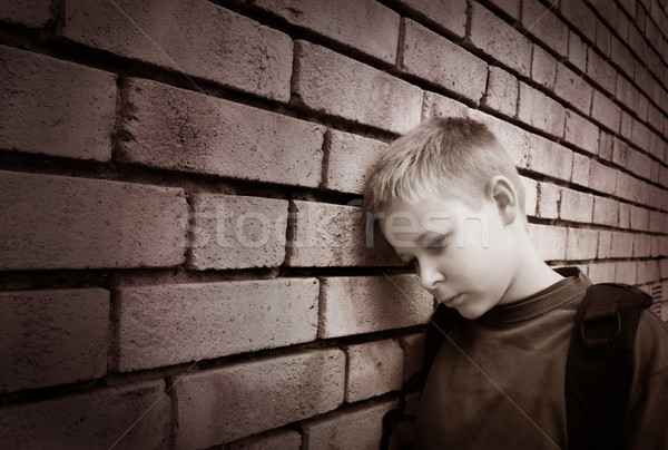 boy leaning against a wall Stock photo © mikdam