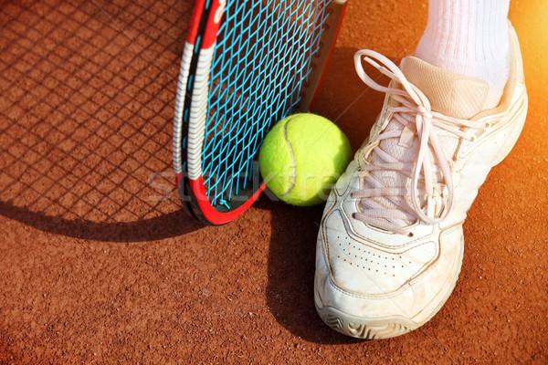 Legs of man near the tennis racquet and balls Stock photo © mikdam