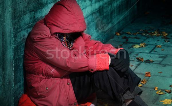 Bánat nő ül tégla épület női Stock fotó © mikdam