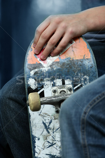 Kid holding a skateboarder Stock photo © mikdam