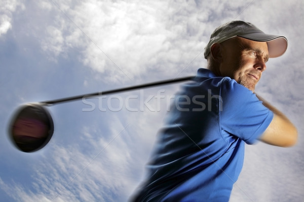 golfer shooting a golf ball  Stock photo © mikdam
