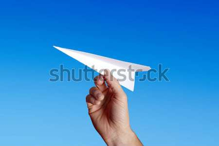 throwing a paper plane.. Stock photo © mikdam
