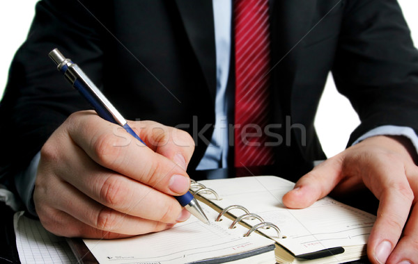 Businessman and a agenda Stock photo © mikdam