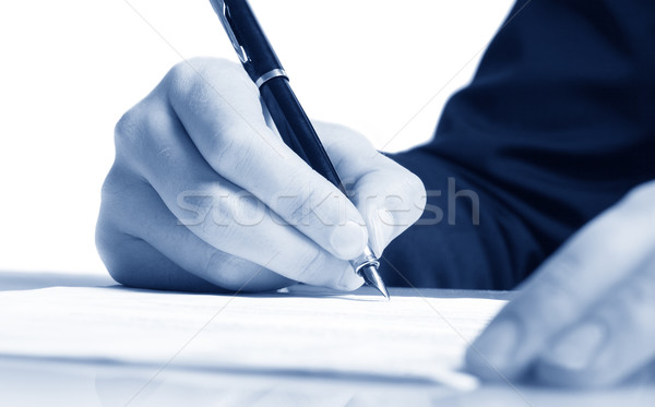 Completing the Form on White Table Stock photo © mikdam