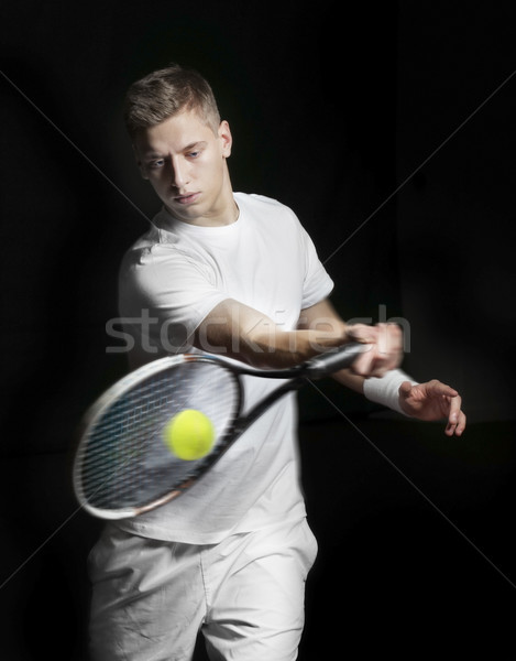 Young man playing tennis Stock photo © mikdam