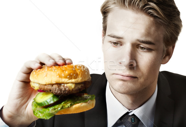Businessman eating at work Stock photo © mikdam