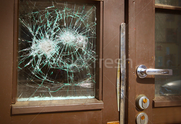 Broken window on  door by vandalism Stock photo © mikdam