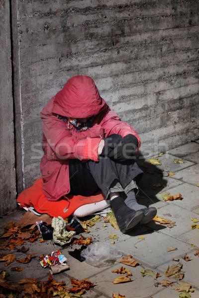 Bánat nő ül tégla épület fej Stock fotó © mikdam