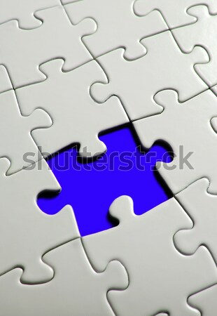 Missing puzzle  piece, focus around the empty space. Stock photo © mikdam