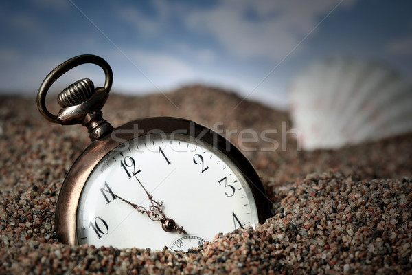 Old pocket watch buried in sand Stock photo © mikdam