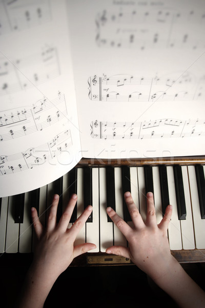 child's hands playing on a old piano  Stock photo © mikdam