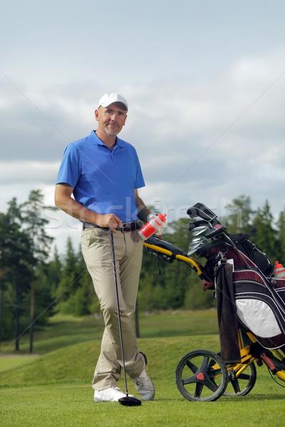 Man standing by golf bag full of sticks  Stock photo © mikdam