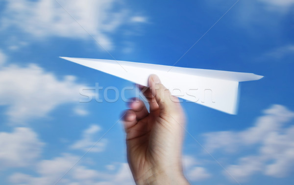 throwing a paper plane.. , motion blur Stock photo © mikdam