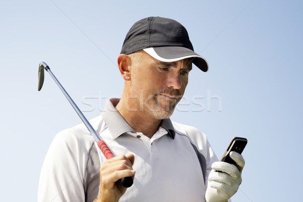 Golfer using mobile phone Stock photo © mikdam
