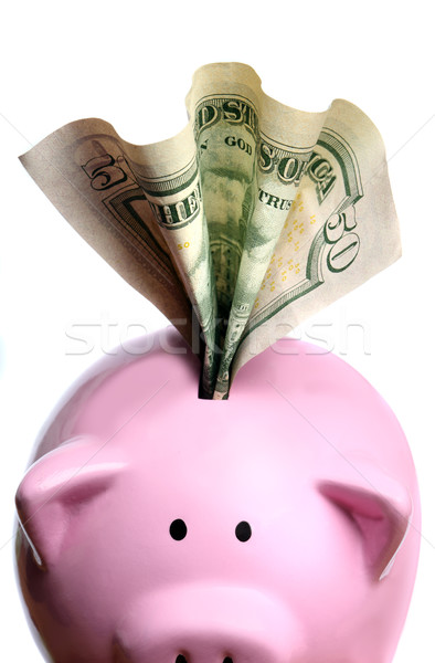 Stuffed piggy bank with US dollars Stock photo © mikdam