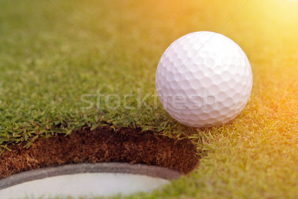 Golfball almost in the hole  Stock photo © mikdam