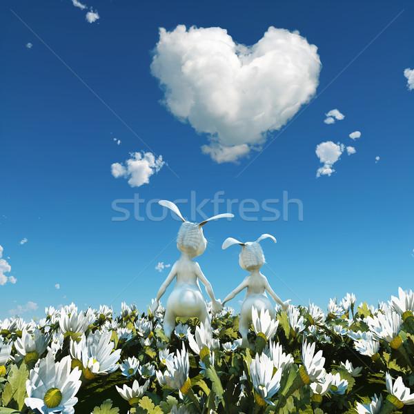 two easter rabbit on white flower field Stock photo © mike_kiev