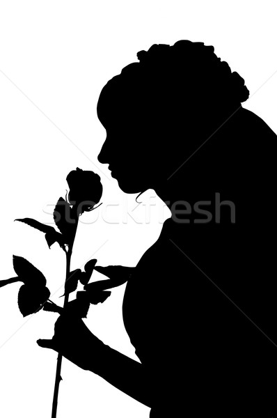 Silhouette of woman in wedding dress with rose Stock photo © mikhail_ulyannik
