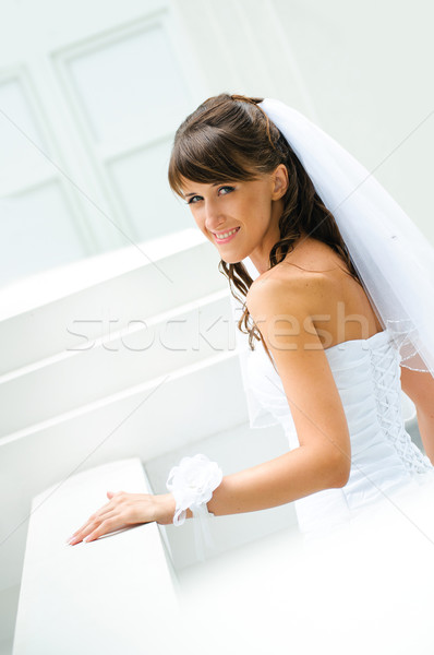 smiles bride in white dress with a veil on white outdoor backgro Stock photo © mikhail_ulyannik