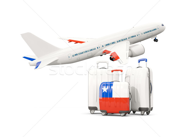 Luggage with flag of chile. Three bags with airplane Stock photo © MikhailMishchenko