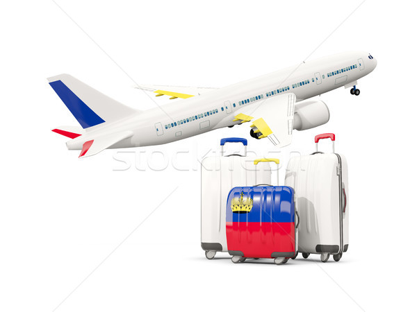 Luggage with flag of liechtenstein. Three bags with airplane Stock photo © MikhailMishchenko