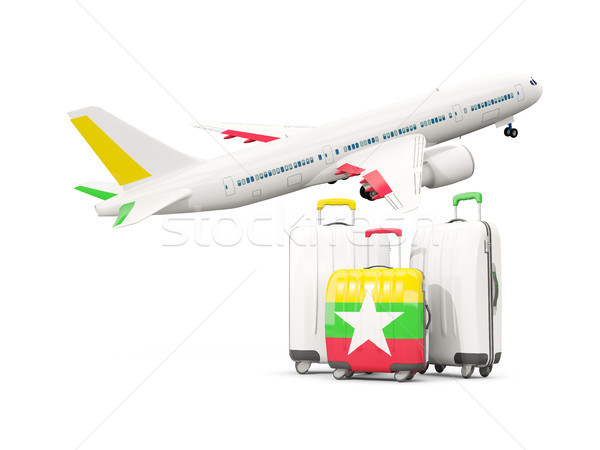Luggage with flag of myanmar. Three bags with airplane Stock photo © MikhailMishchenko