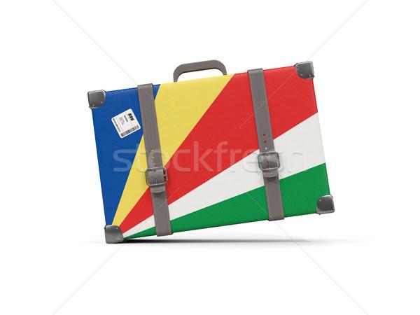 Csomagok zászló Seychelle-szigetek bőrönd izolált fehér Stock fotó © MikhailMishchenko