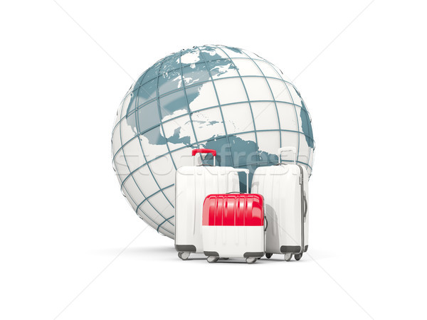Luggage with flag of indonesia. Three bags in front of globe Stock photo © MikhailMishchenko