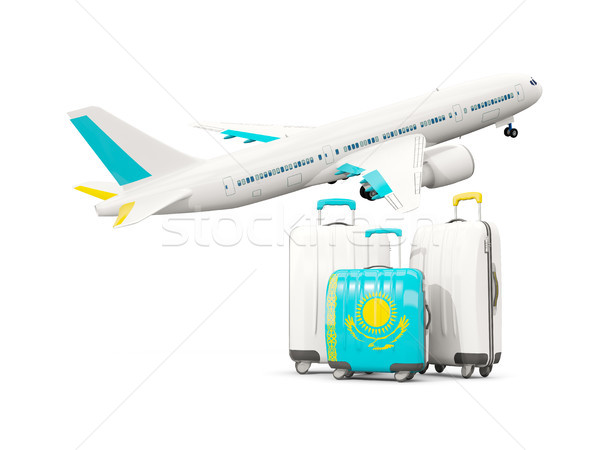 Luggage with flag of kazakhstan. Three bags with airplane Stock photo © MikhailMishchenko